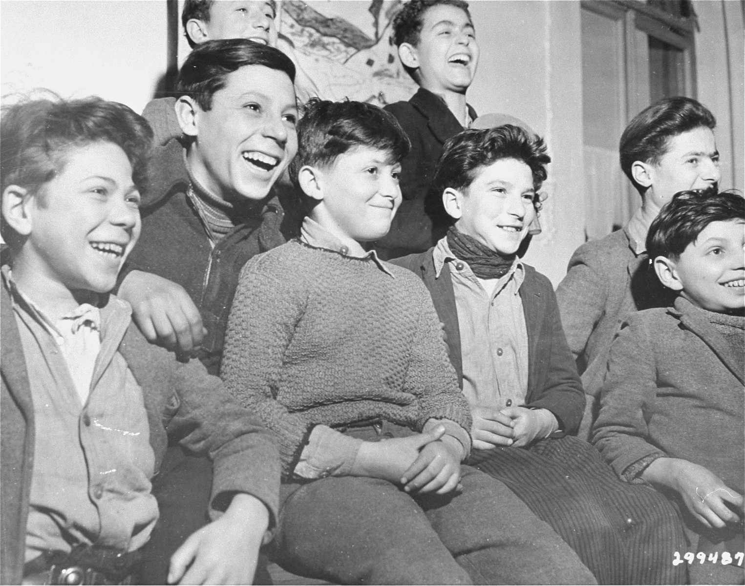 Jewish orphans laugh during a performance at the Lindenfels displaced person's center for children.