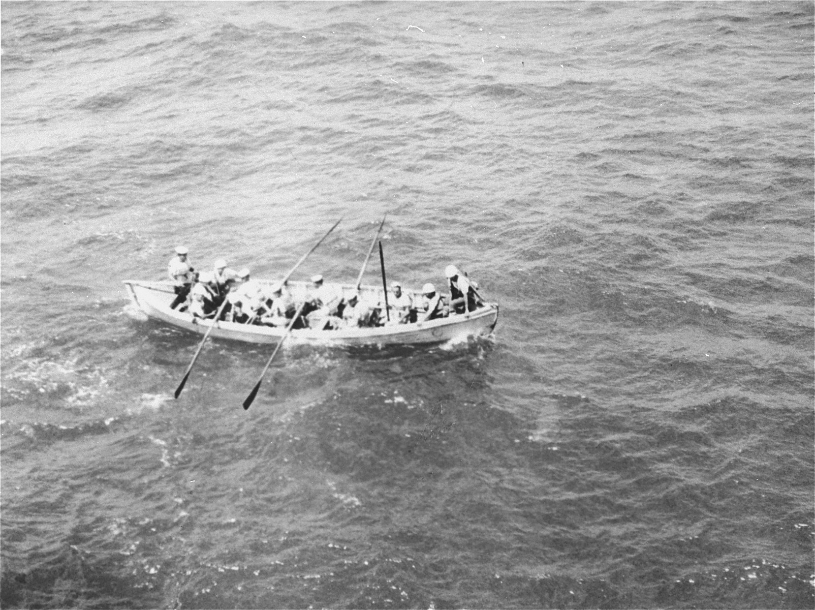 A boarding party from the British destroyer, H.M.S. Ajax, approaches the Exodus 1947.