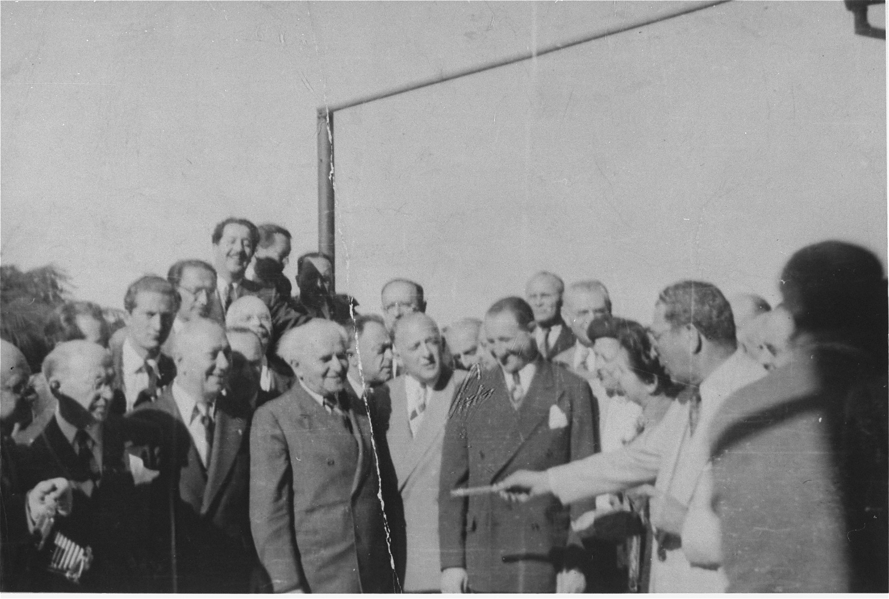 David Ben-Gurion is offered a cigar at a meeting with other Jewish leaders in Haifa during the transfer of Exodus 1947 passengers.