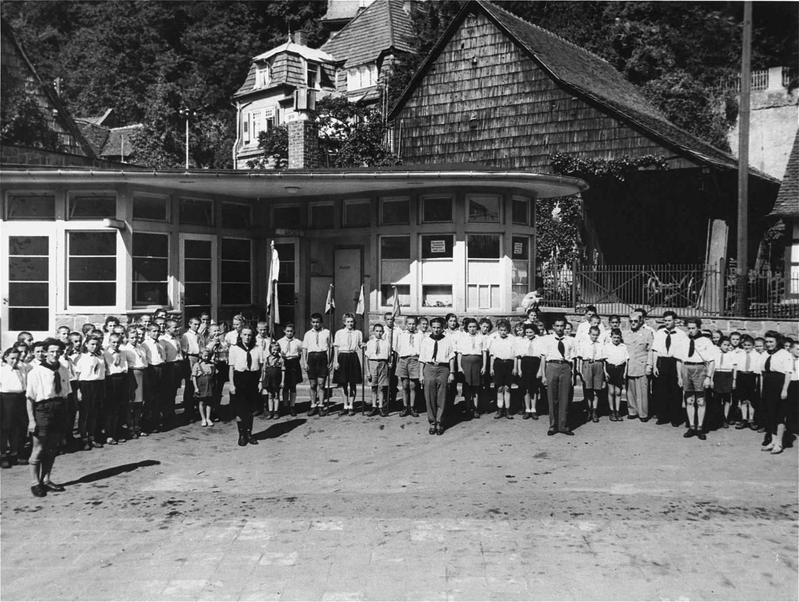 Group portrait of the children and teachers of the Lindenfels displaced persons' center for children.  Among those pictured are Mayer Zarnowiecki and the donor, Rose Guterman, who together headed the teaching staff.  The children's center was administered by members of the Hashomer Hatzair Zionist youth movement, who prepared the children for immigration to Palestine.