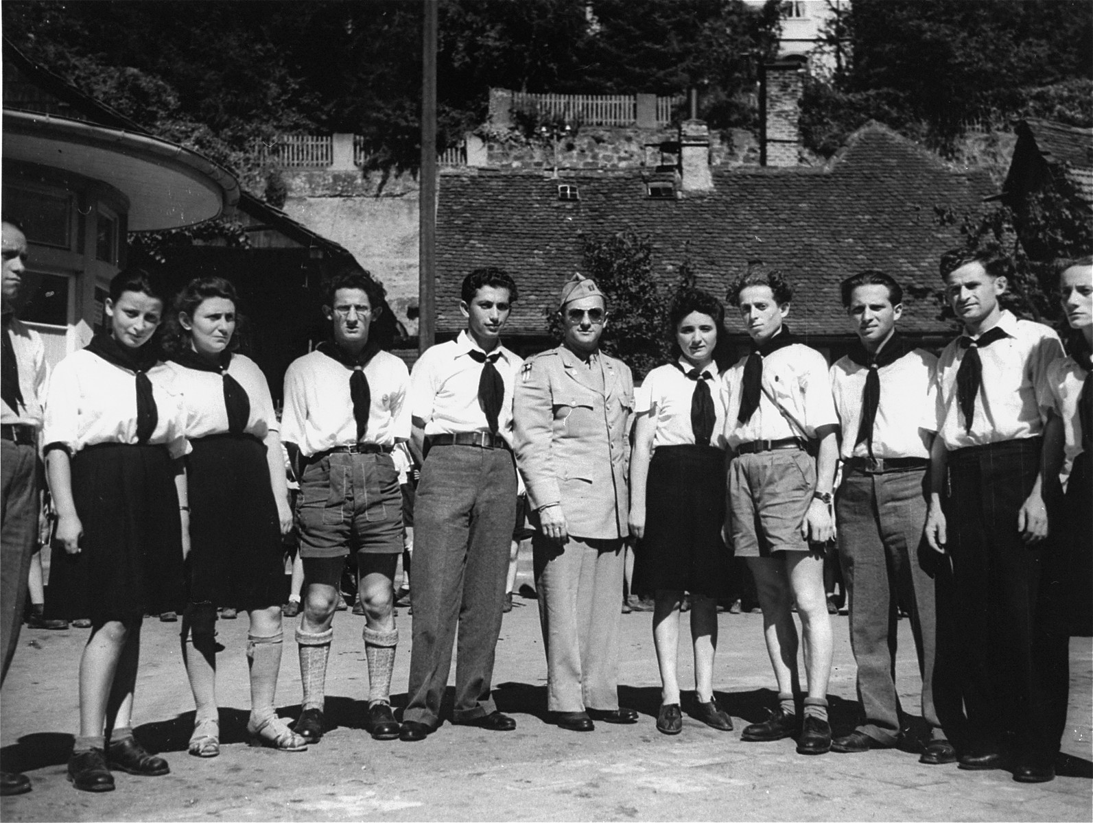 Group portrait of the teaching staff of the Lindenfels displaced persons' center for children.  Among those pictured are Mayer Zarnowiecki (fourth from the left), Mundek Brand (eighth from the left), Mordechai Gruszko (ninth from the left), and the donor, Rose Guterman (extreme right).  The children's center was administered by members of the Hashomer Hatzair Zionist youth movement, who prepared the children for immigration to Palestine.