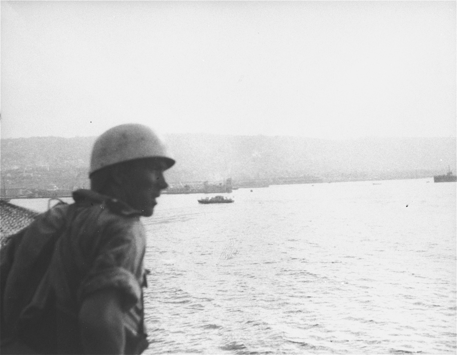 A British marine views the port of Haifa from the deck of the Exodus 1947.