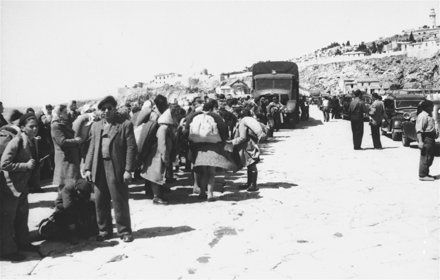 Exodus 1947 refugees wait to board the President Warfield on a quay in Sete's harbor, on their way to Palestine.