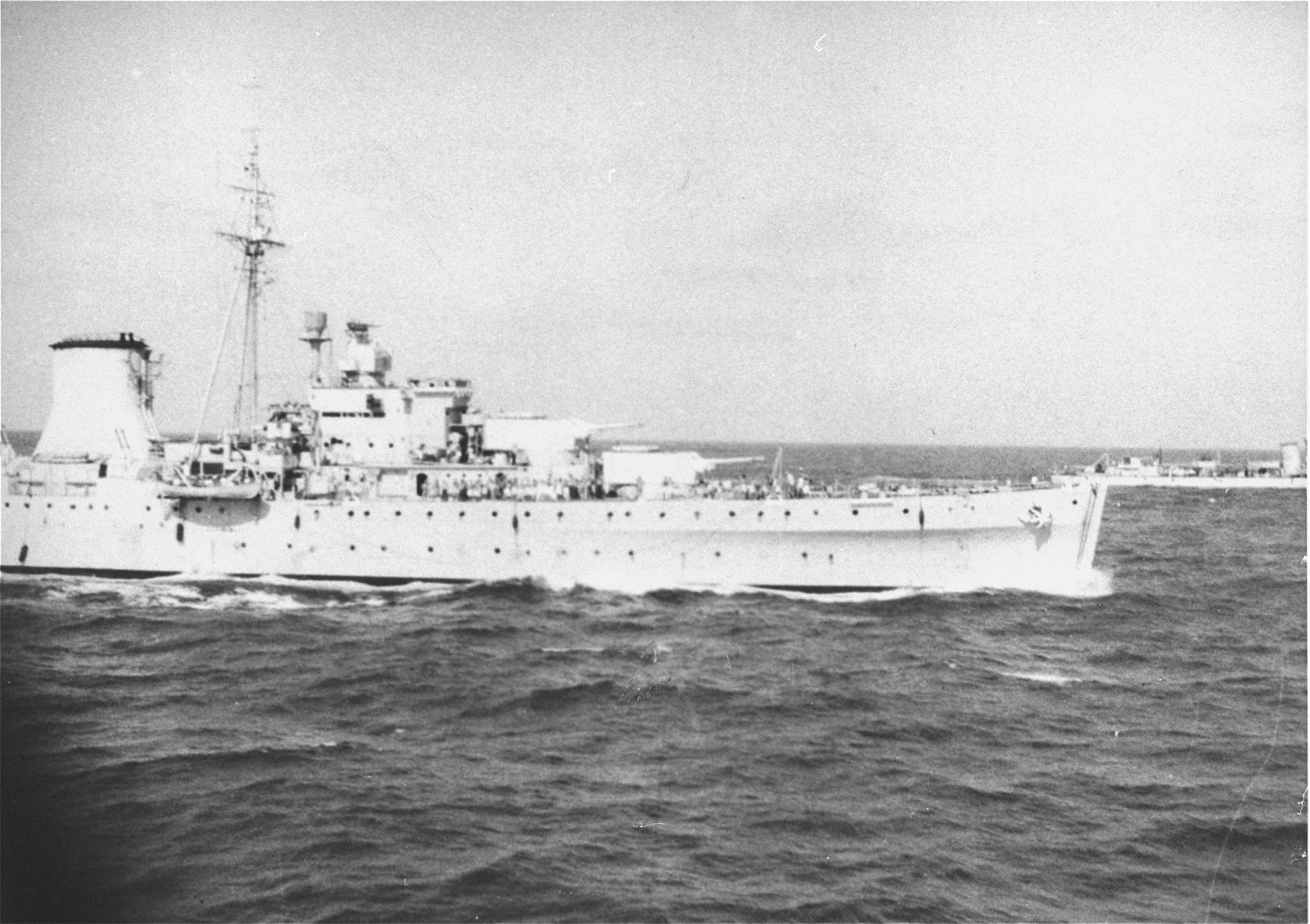 Two British warships that have been dispatched to prevent the landing of the Exodus 1947, approach the illegal immigrant ship off the coast of Palestine.