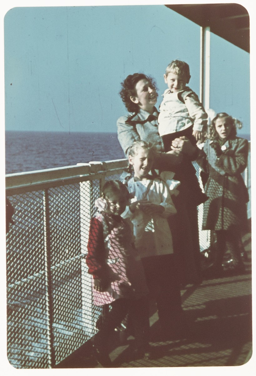 Sarah Spiegel Robinson poses with her  three young children on the deck of  the ship taking them to the United States.