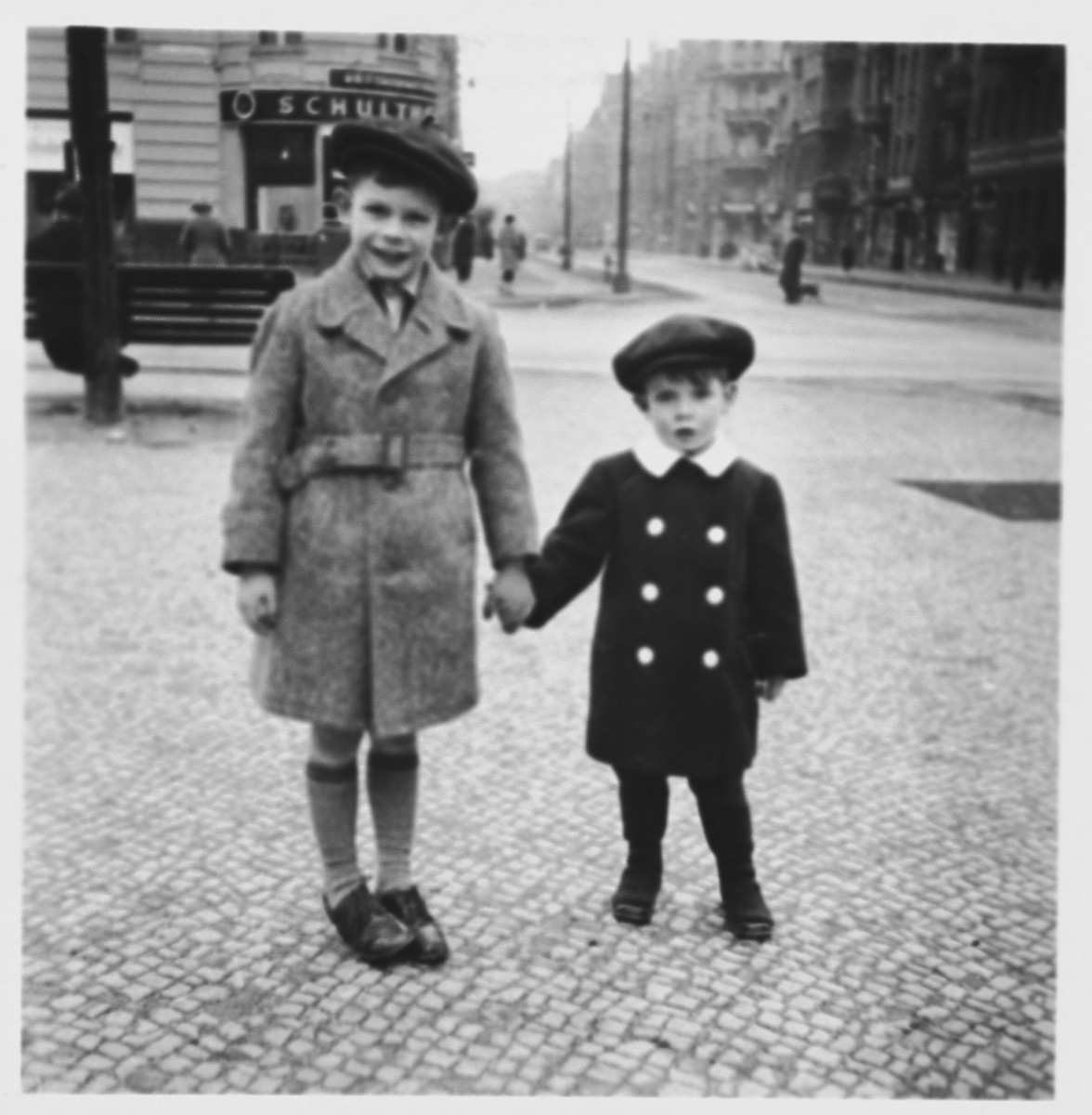 Ralf Harpuder and his older cousin Peter pose on a sidewalk in Berlin.  Peter later perished in the Holocaust.