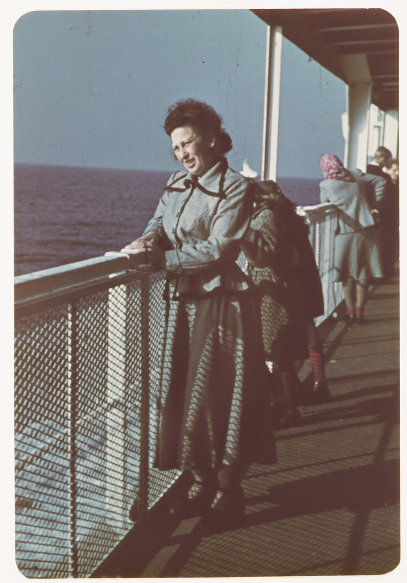 Sarah Spiegel Robinson poses on the deck of  the ship taking bringing her to the United States.