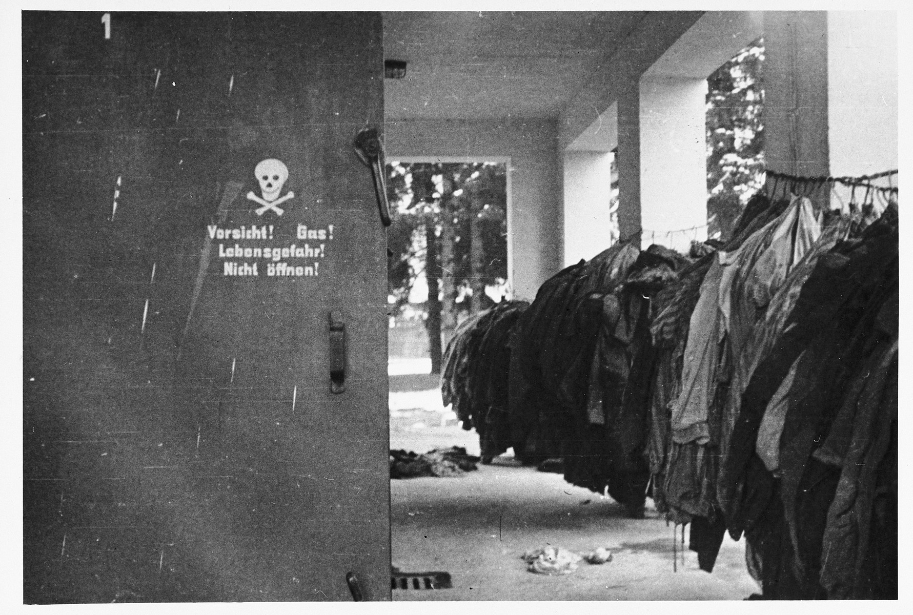 View of clothing hanging outside the gas chamber in the Dachau concentration camp.
