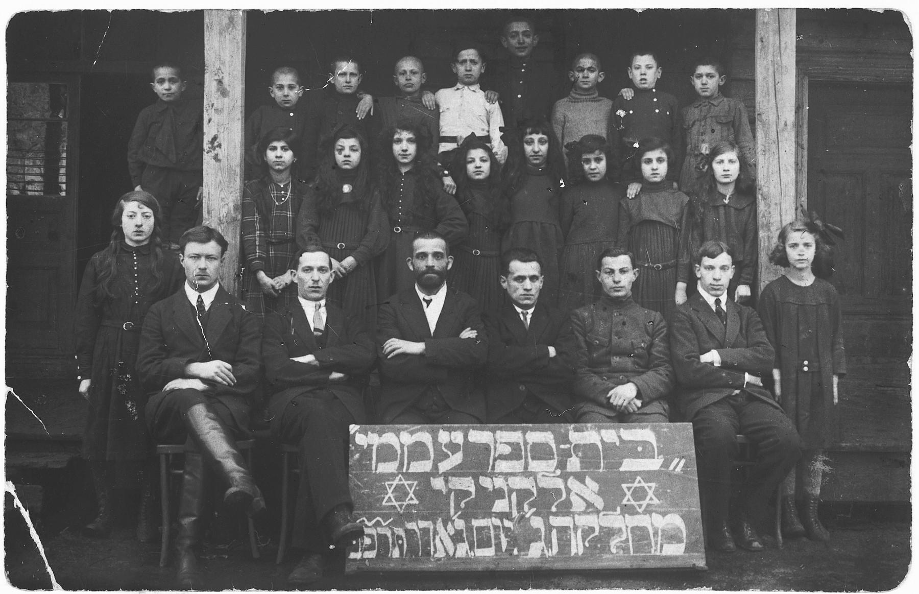 Group portrait of the students and teachers of the Hebrew public school in Olkieniki (Valkininkai).