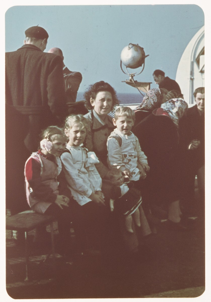 Sarah Spiegel Robinson poses with her  three young children on the deck of  the ship taking bringing them to the United States.