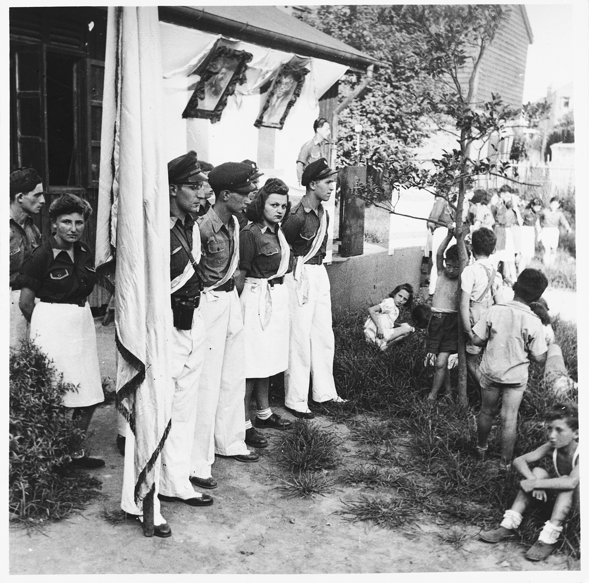 Members of the Betar Zionist movement stand at attention in an outdoor meeting in Shanghai.