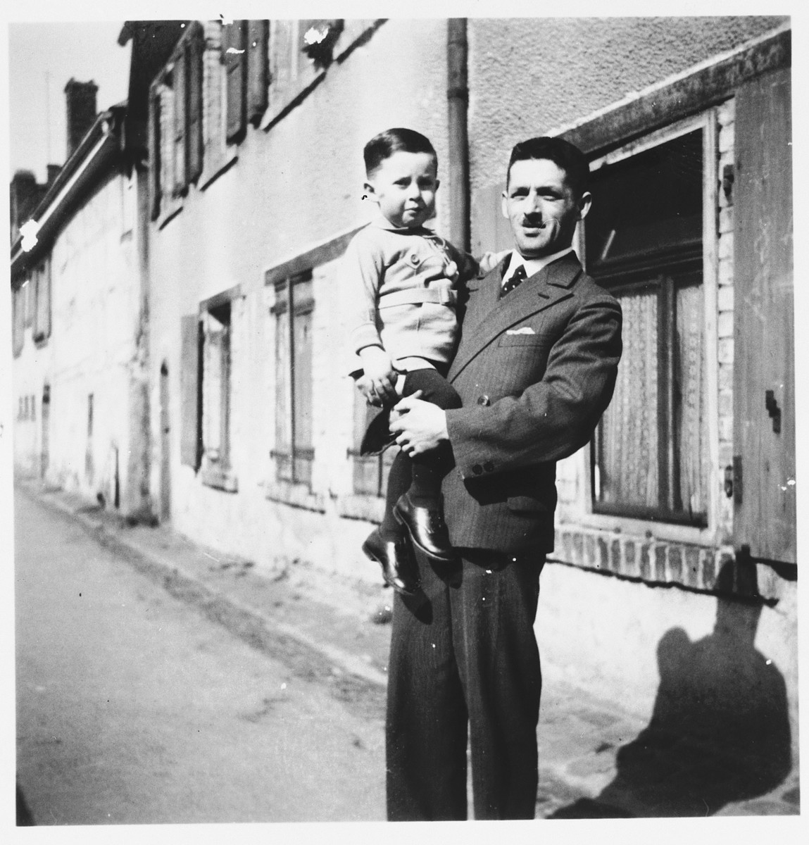 Hugo Odenheimer holds his young son Hugo and poses on a street in Buhl, Germany.