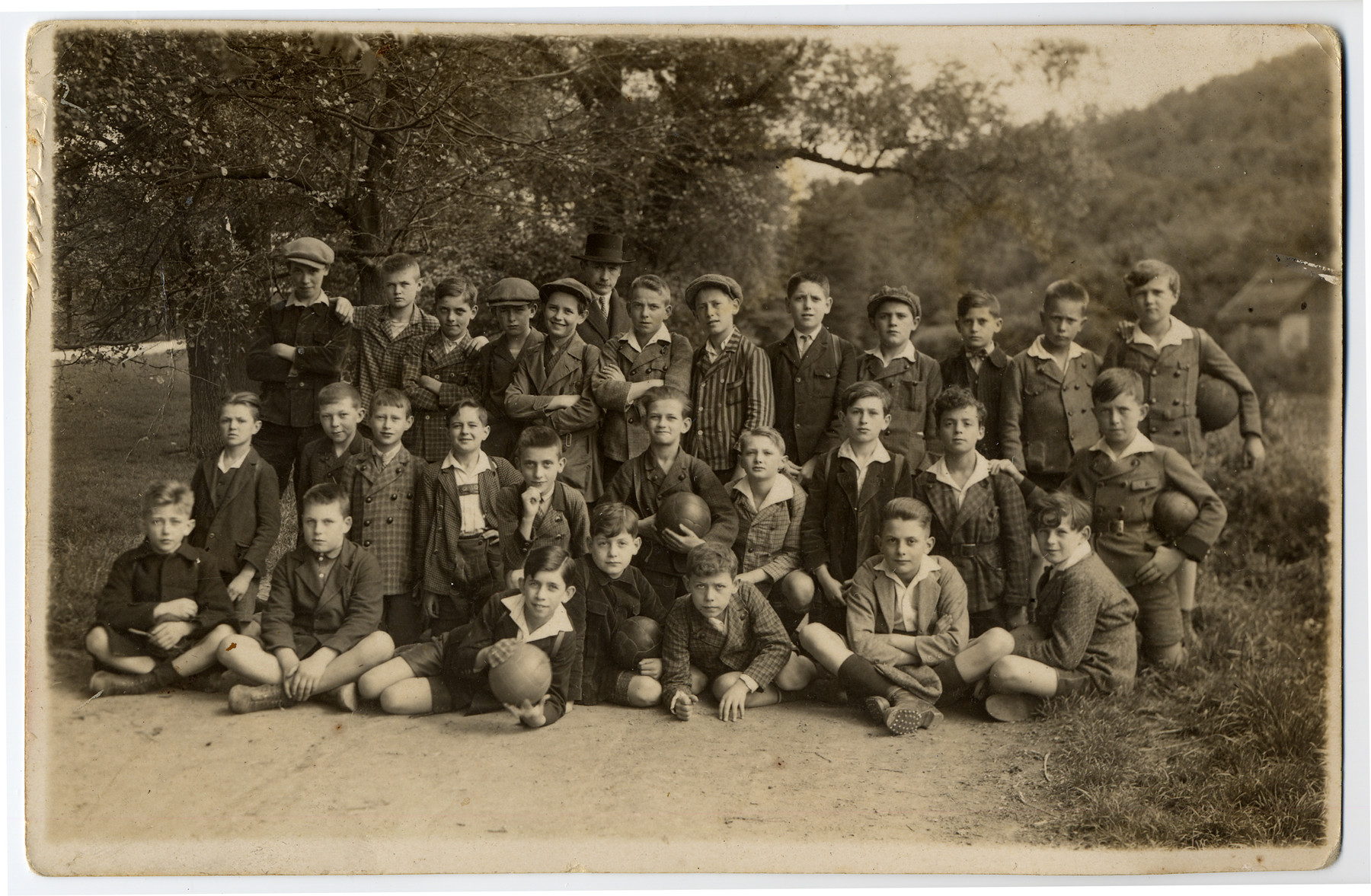 Group portrait of members of and elementary school on an outing in Vienna.  Sioma Lechtman is pictured in the middle row, second from the right.