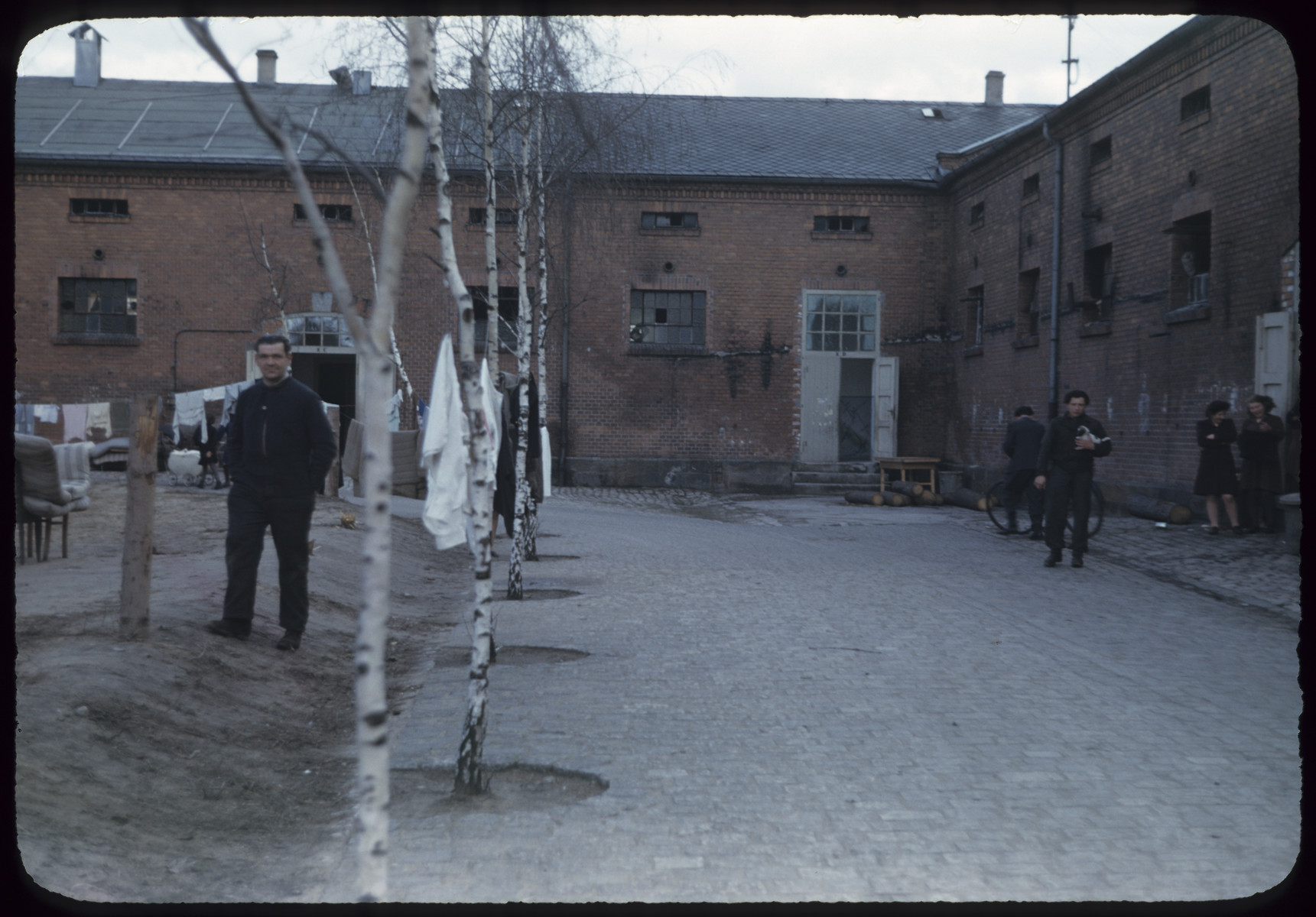 View of displaced persons in a courtyard in the Bamberg displaced persons camp in Germany.