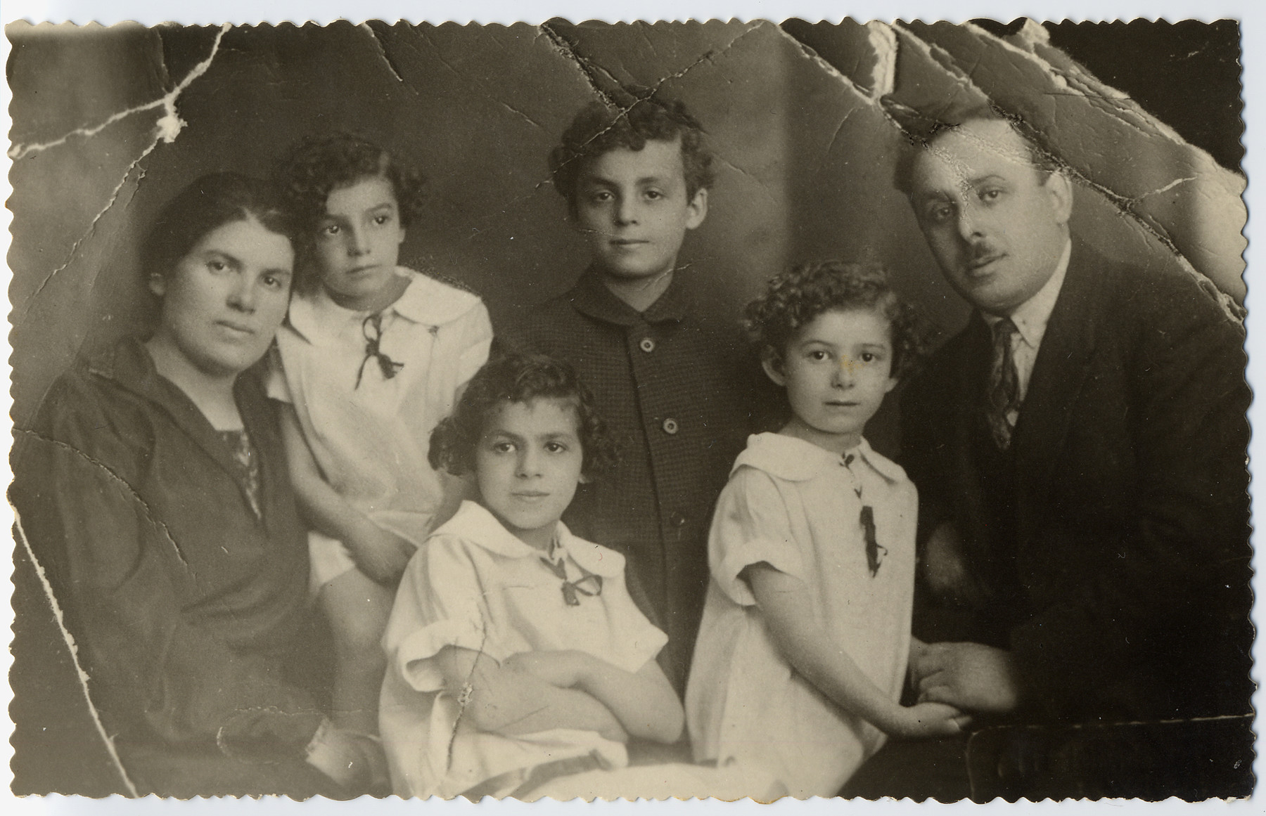 Portrait of the Lechtman family in Vienna, Austria.  Pictured from left to right are Feiga Blatt Lechtman, Luba, Hava, Sioma, Lea (Luba's twin sister) and Israel Lechtman.