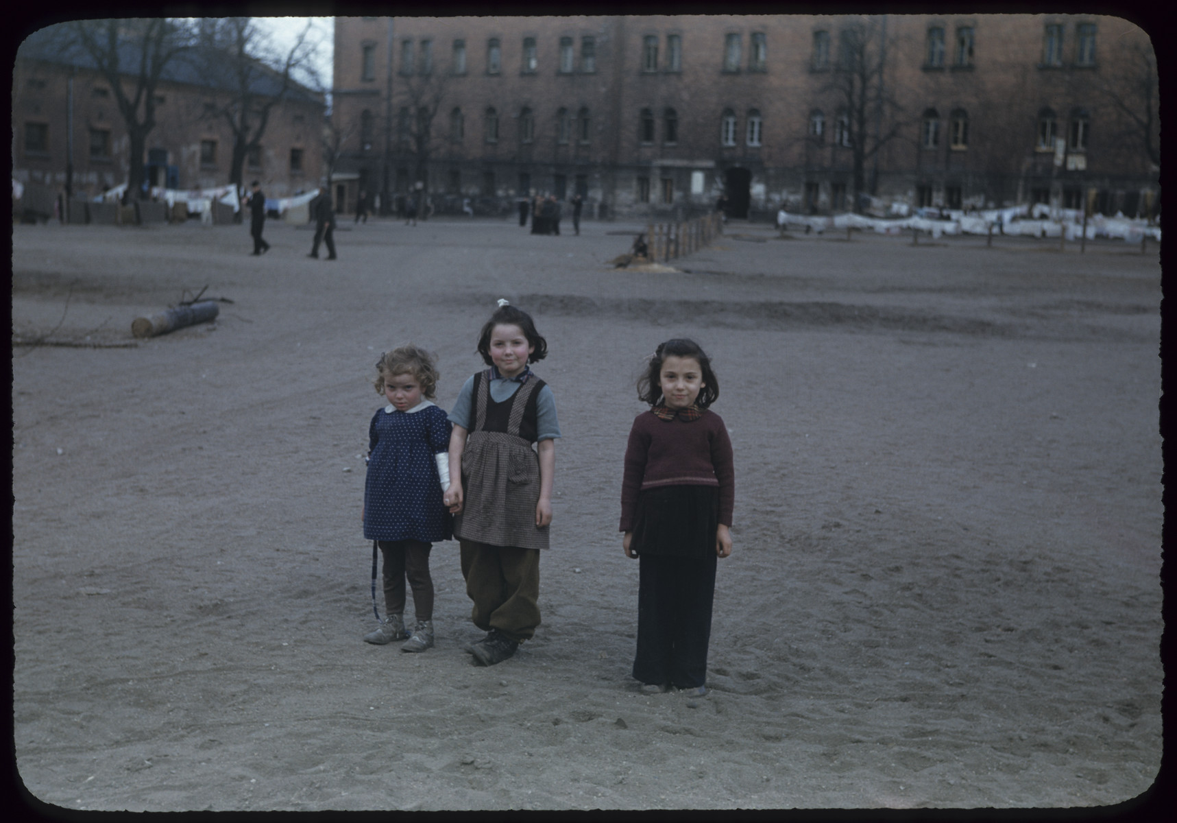Three young girls pose at the Bamberg displaced person's camp (Uhlan barracks) in Germany.