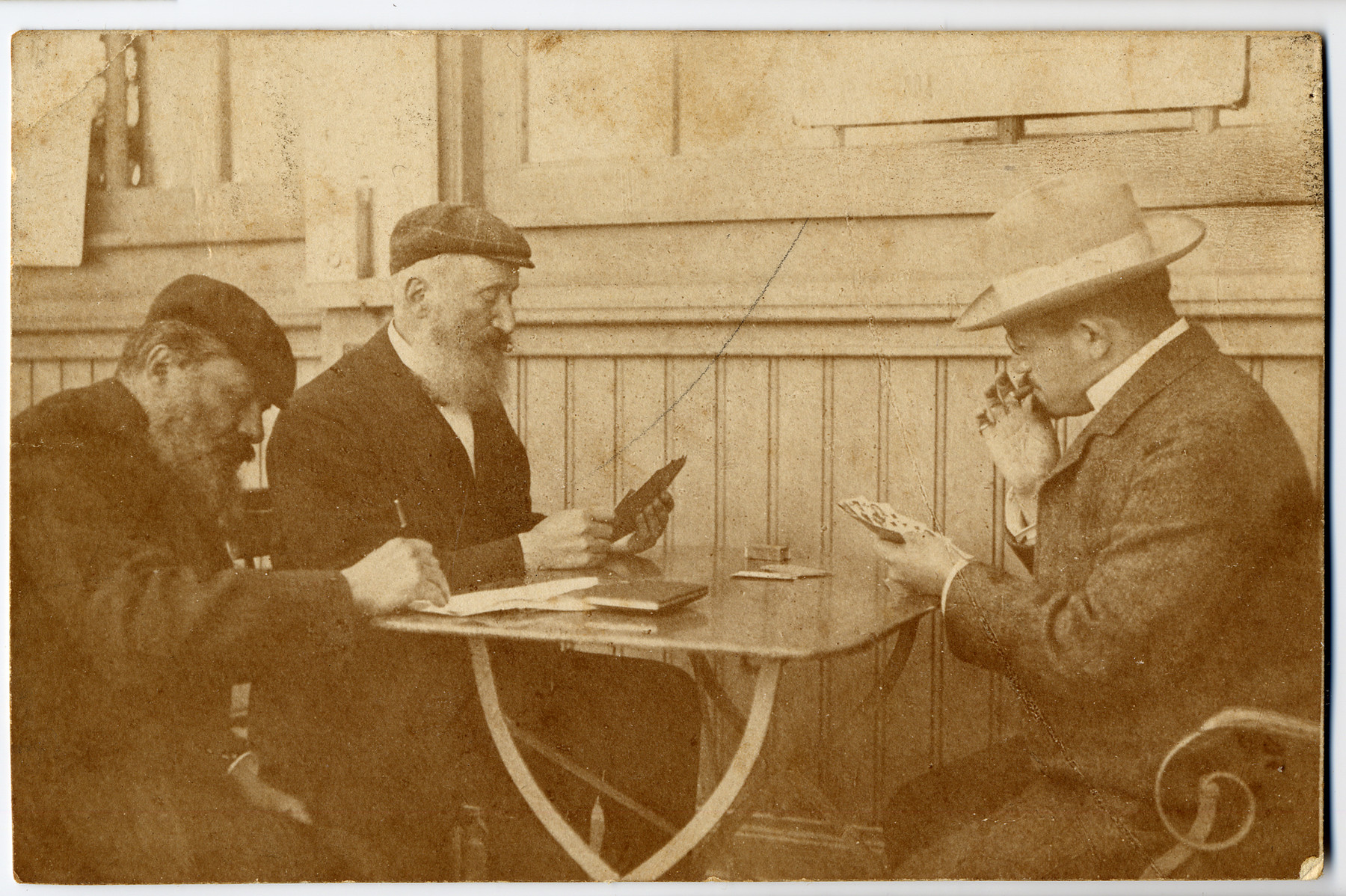 Three Jewish men play a game of cards in Vienna Austria.  Among those pictured are Joel Wegmaister and Israel Lechtman, the two grandfathers of Tonia Bialer.