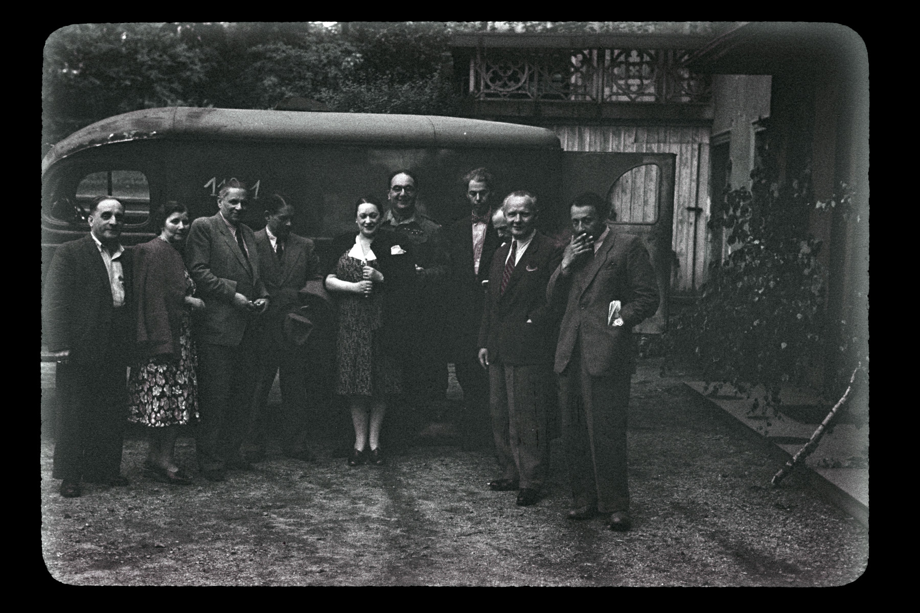 Group portrait of people posing in front of a bus in Upper Silesia.