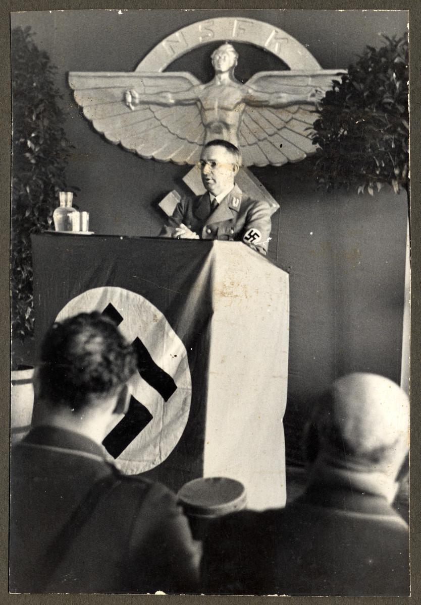 Dr. Alfred Meyer, Gauleiter of Westfalen-Nord, speaks at an NSFK (Nationalsozialistisches Fliegerkorps, National Socialist Fliers Corps) speaks at a meeting in Borkenberge airfield.
