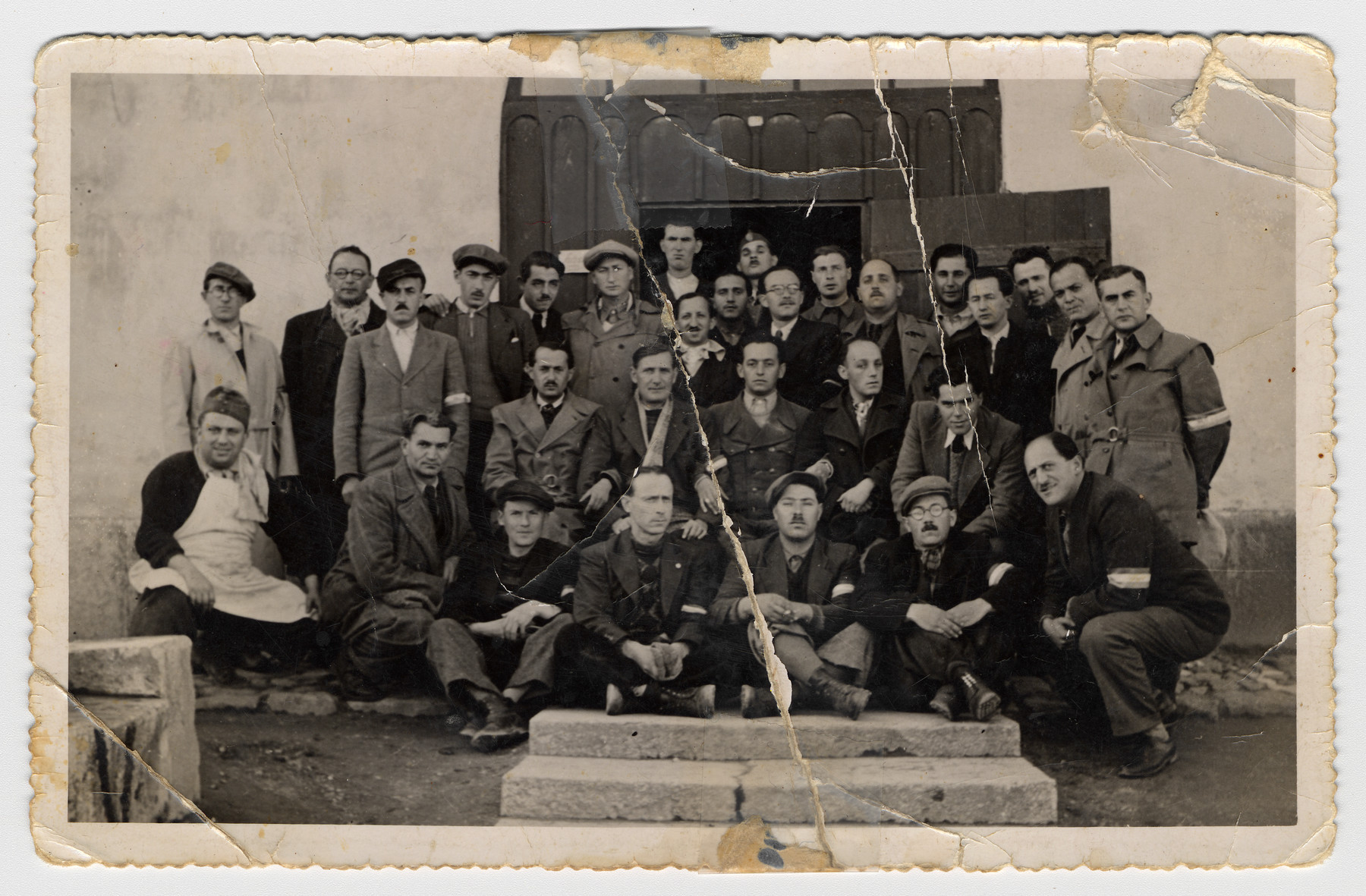 Group portrait of Jews in a Hungarian forced labor battalion, perhaps in Zircz.  Iszo Stern is standing in the back row second from the left.