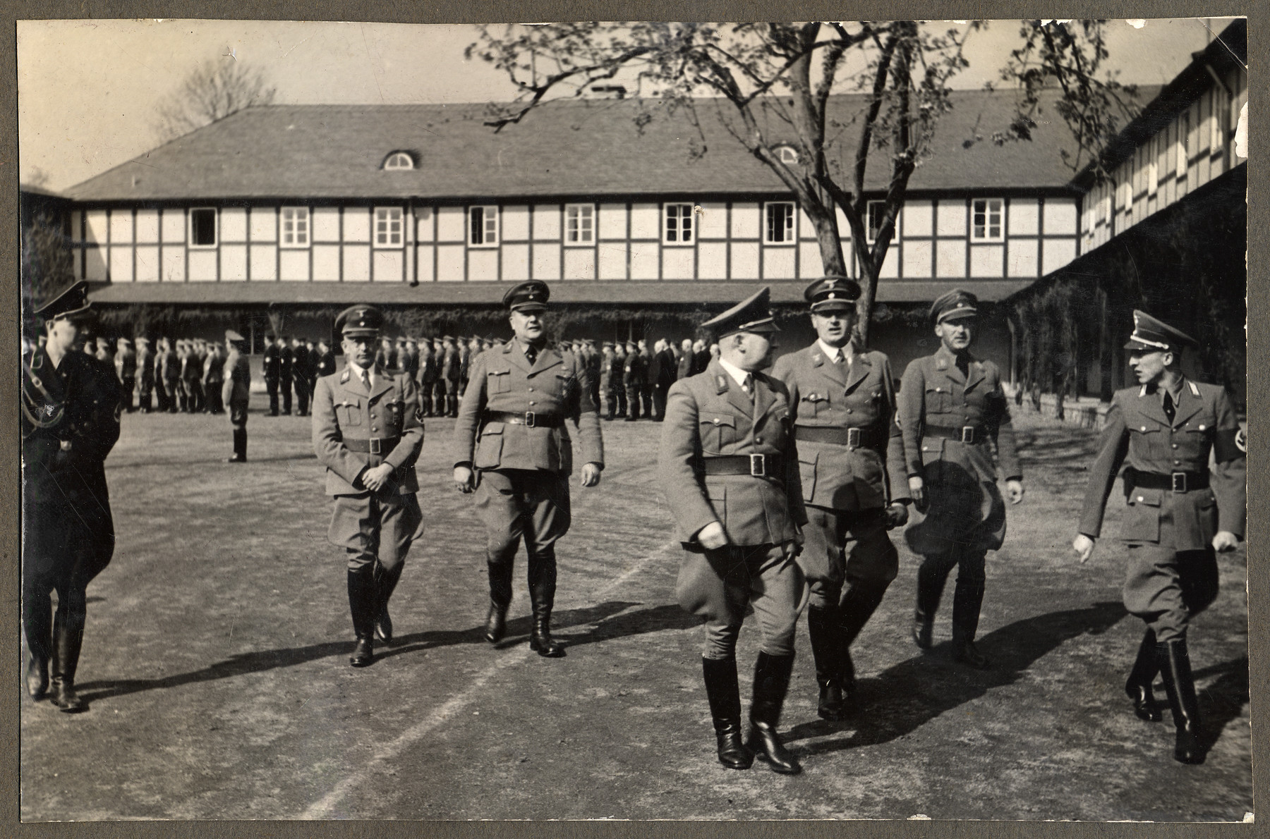 Nazi officials walk in a courtyard at the seminar for Reich training in Erwitte.