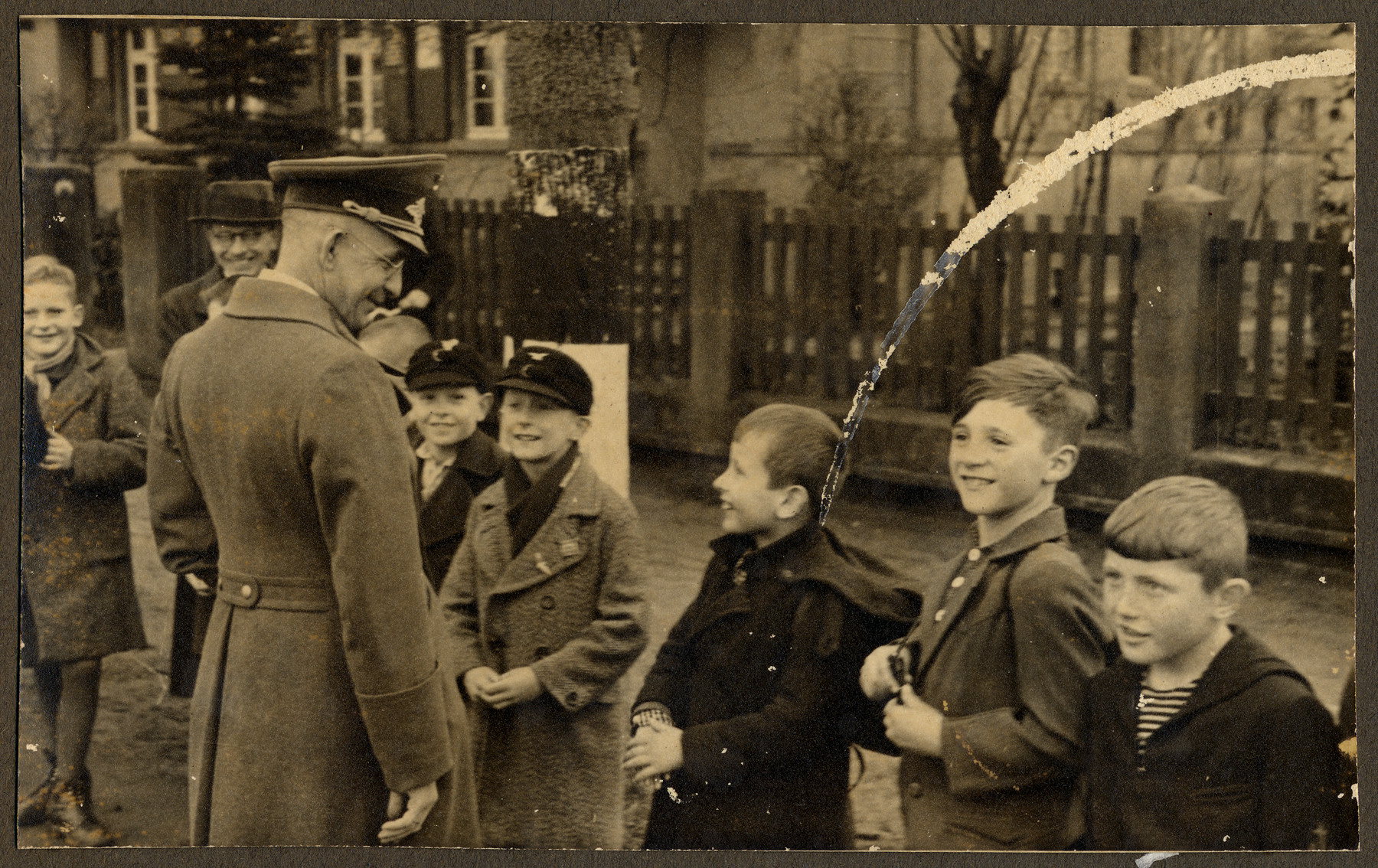 Alfred Meyer (1891-1945), Gauleiter Westfalen-Nord, and Rosenberg's state secretary for the Eastern occupied territories meets with a group of young boys during Rosenberg's visit to Muenster.