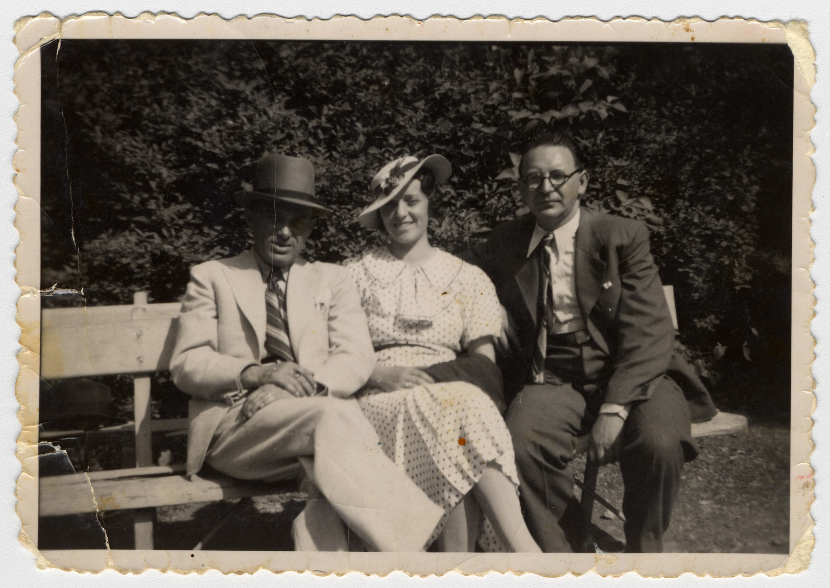 Three Hungarian Jews sit on a park bench in Budapest.  Pictured on the far right is Izso Stern.