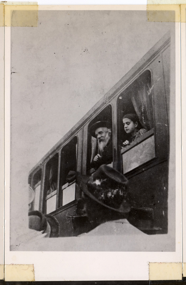 The Munkacer Rav, Rabbi Chaim Elazar Spira, otherwise known as the Minchat Eliezer, looks out the window of a train.