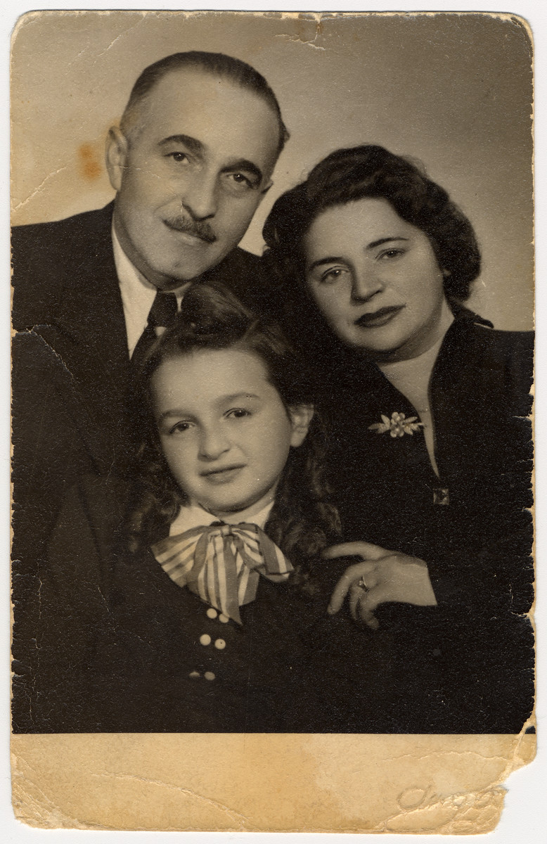 Studio portrait of a Hungarian Jewish family who survived the last year of the war in hiding.  Pictured are Rabbi Michael, Lillian and Zsuzsa Rubin.