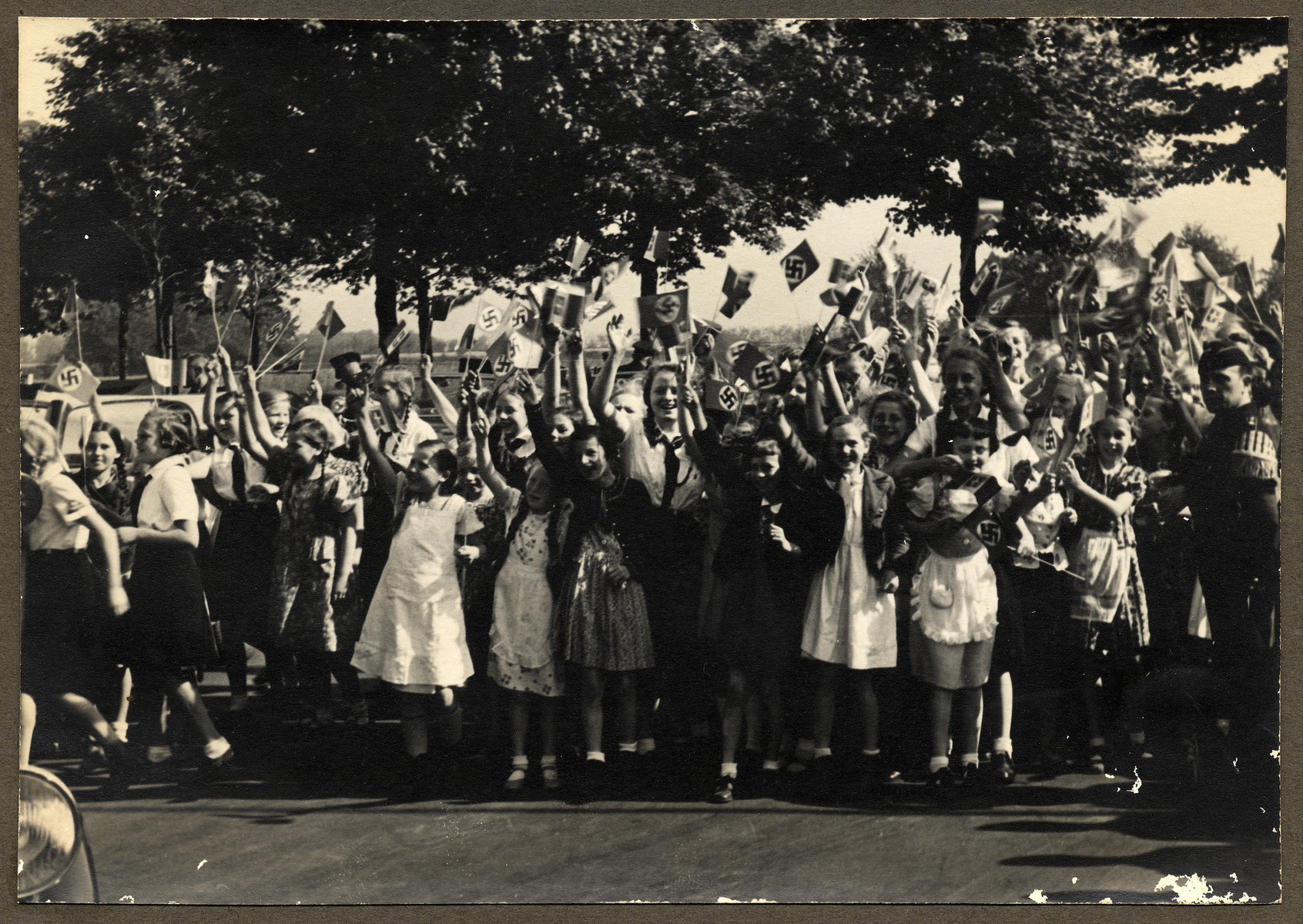 A jublilant crowd with many children waive their flags as they await the arrival of Tullio Cianetti, the Italian Work Minister, to the Scholven factory.