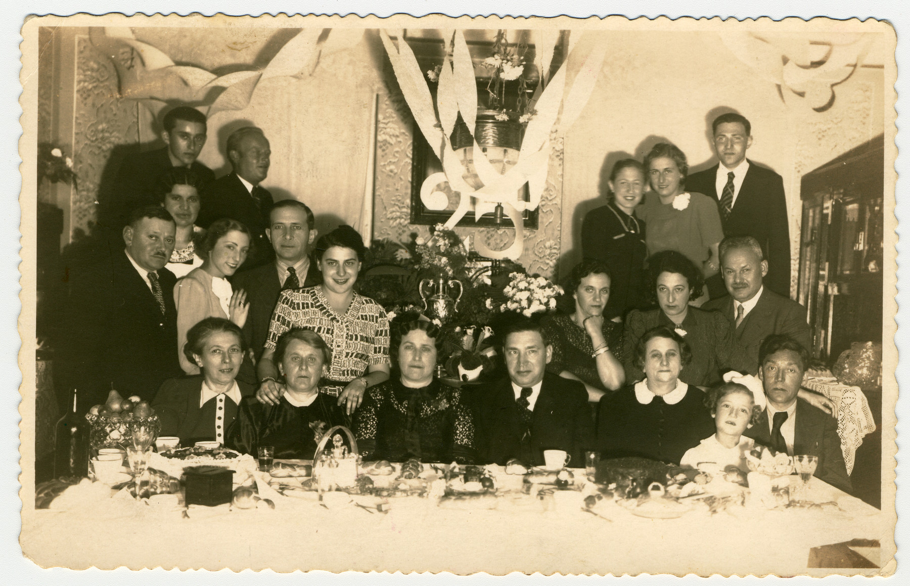 Portrait of the family of a Hungarian-Jewish family in Slovakia and sent to their sister-in-law in Budapest.  Dezso Stern and his wife are seated in the center.  All but two of those pictured perished in the Holocaust.