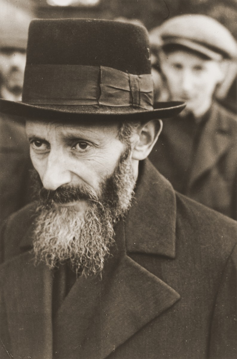 Portrait of a Jew who stands among a larger group of Jewish men that has been rounded-up by German soldiers in Aleksandrow Kujawski.