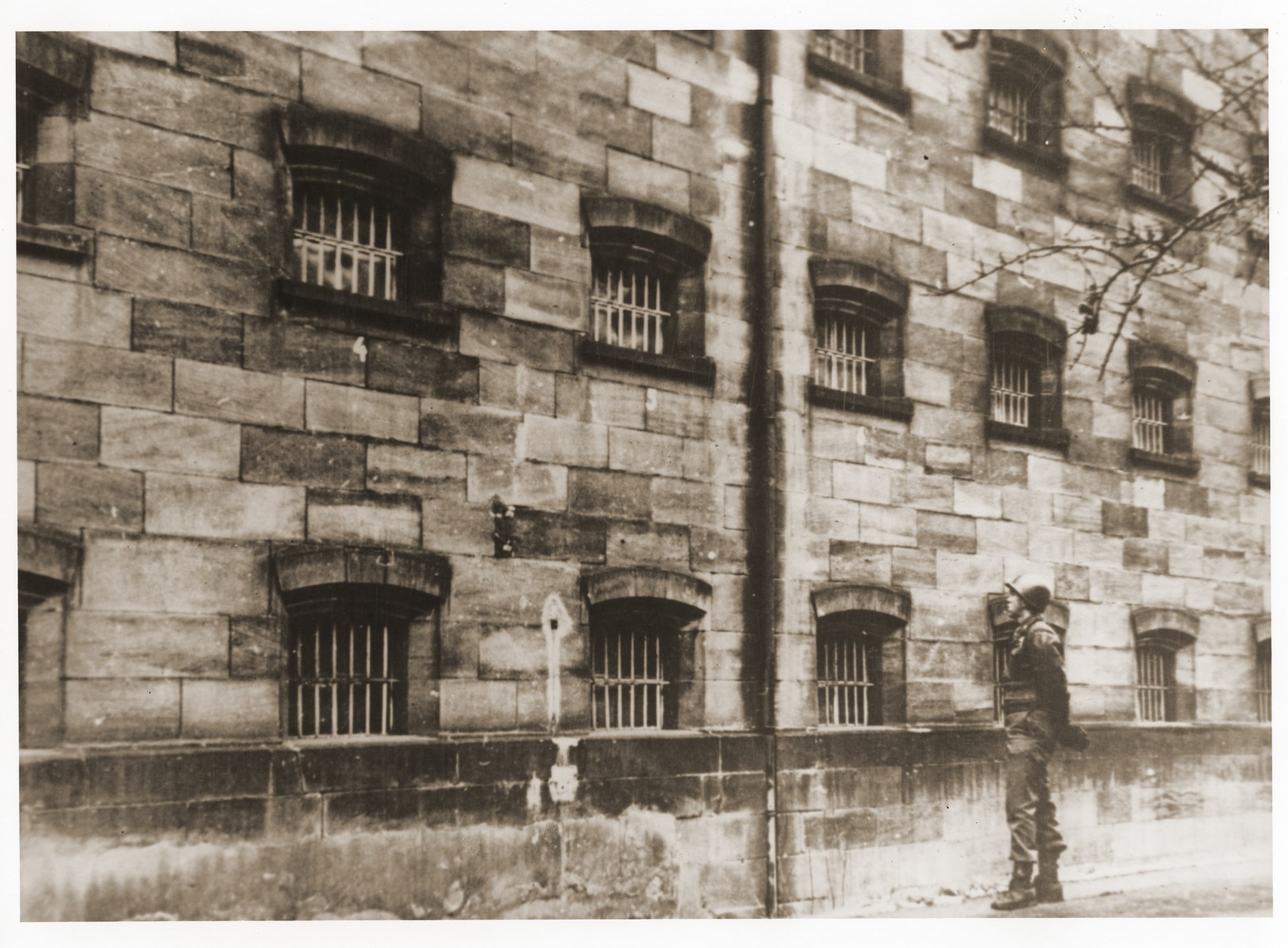 An American soldier stands guard outside the prison where the defendants were held during the International Military Tribunal trial of war criminals at Nuremberg.