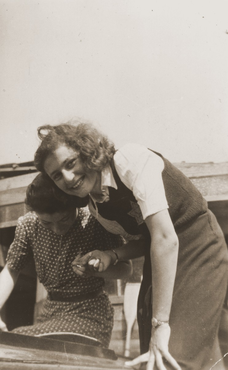 Hilde Jacobsthal, wearing a Jewish star, steps into a boat.