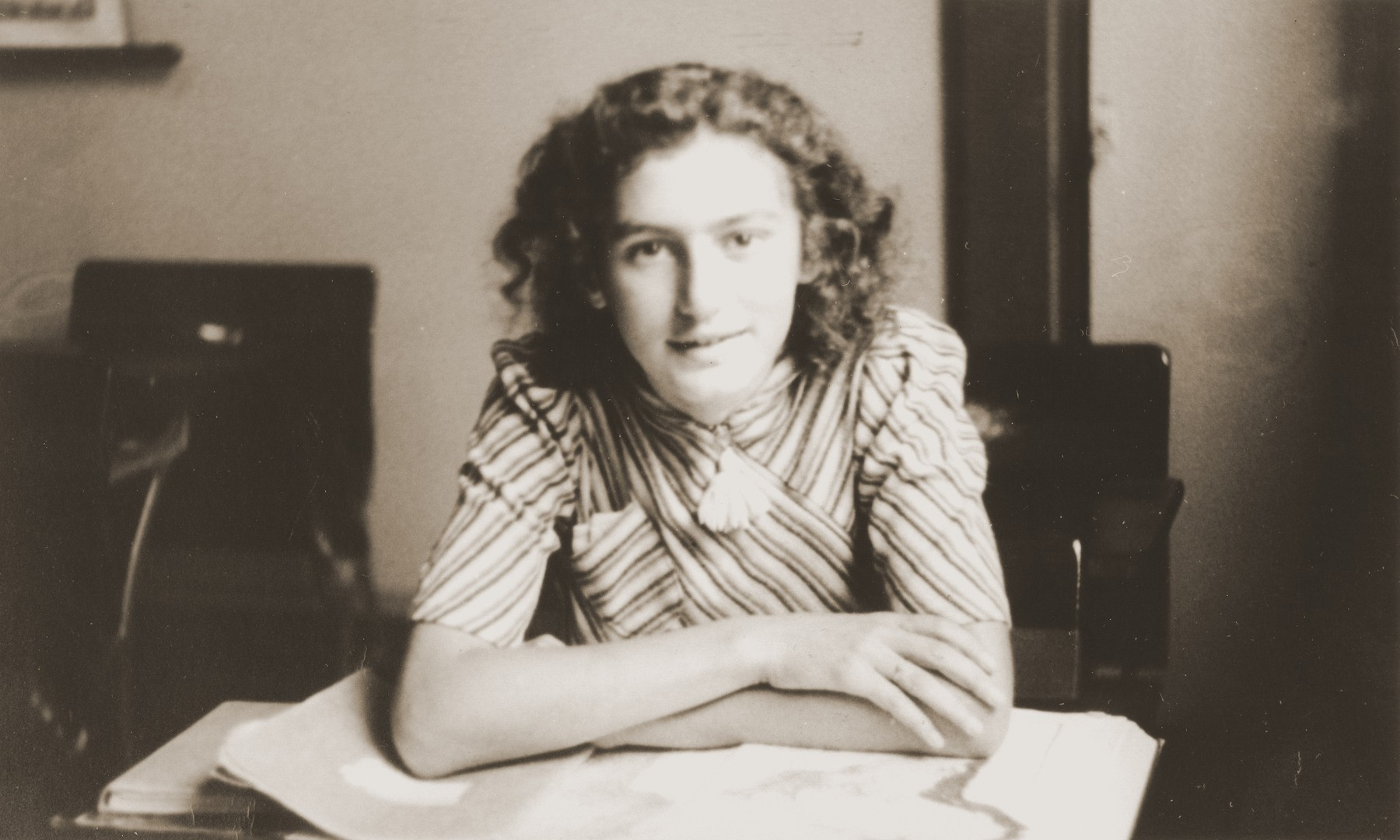 Hilde Jacobsthal seated at a desk in her high school in Amsterdam.