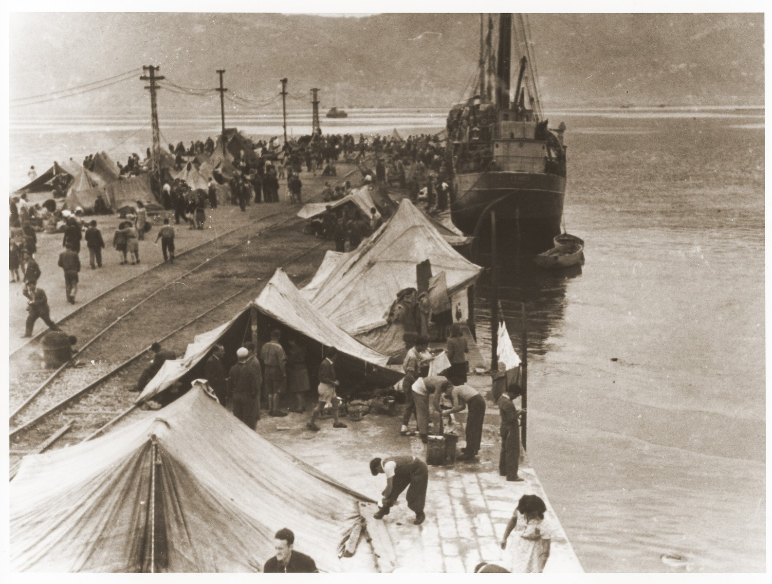 Jewish DPs pitching tents on the pier in La Spezia harbor, where they are holding a hunger strike to protest Britain's refusal to let them sail to Palestine.