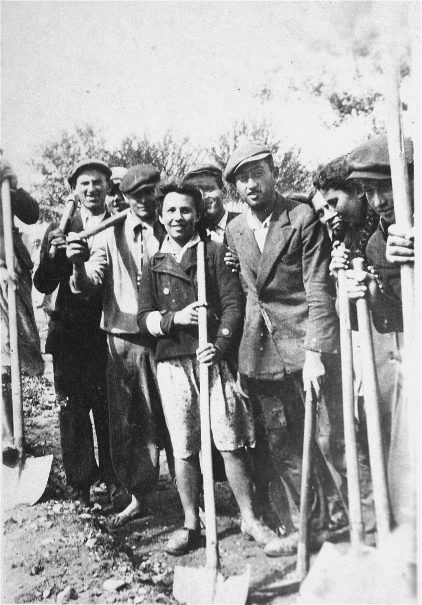 Group portrait of Jews at forced labor building a road in Kolbuszowa.    Among those pictured is Manius Notowicz (right) and Mondi Stub (center next to the young woman).