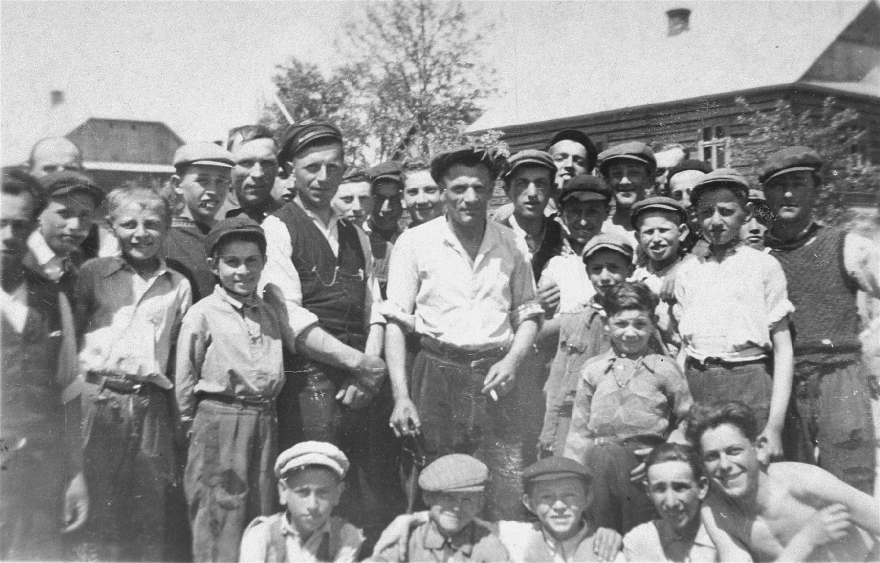 Group portrait of Jewish men and children in the Kolbuszowa ghetto.