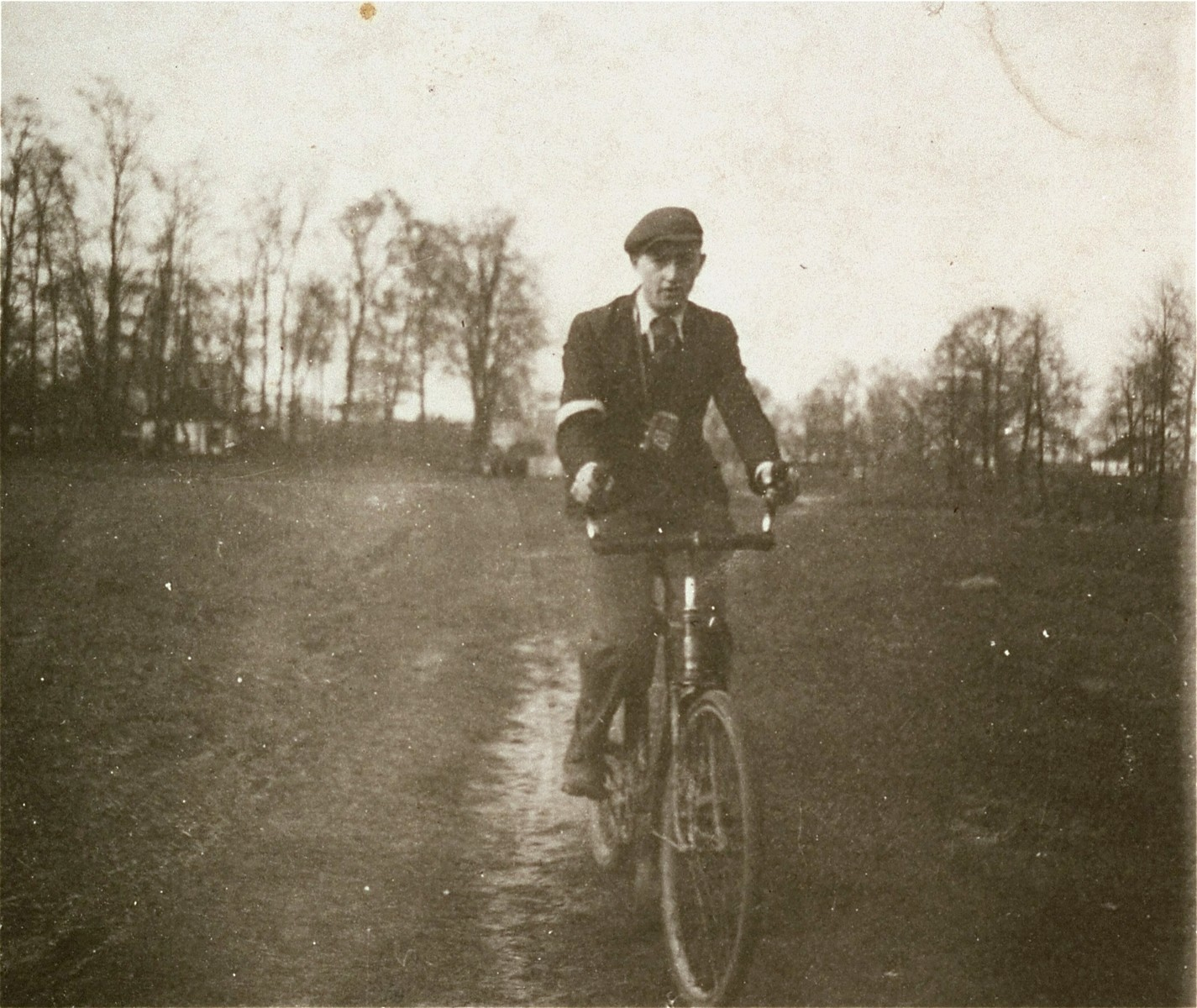 A Jewish boy rides a bicycle in the Kolbuszowa ghetto.   Pictured is Mondi Stub, a friend of Manius Notowicz, the donor.