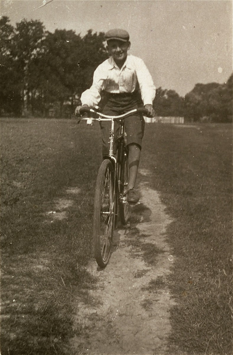 A Jewish boy rides a bicycle in the Kolbuszowa ghetto.   Pictured is 13-year-old Manius Notowicz.