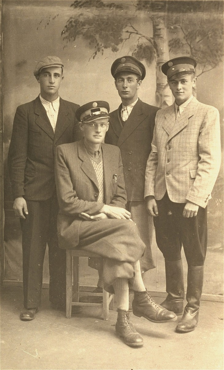 Group portrait of four Jewish policemen in the Kolbuszowa ghetto.    Seated is Josek Rappaport, commandant. Standing, from left to right are: Jankel Lejbowicz; Mendel Bilfeld and Binem Rozenbaum.