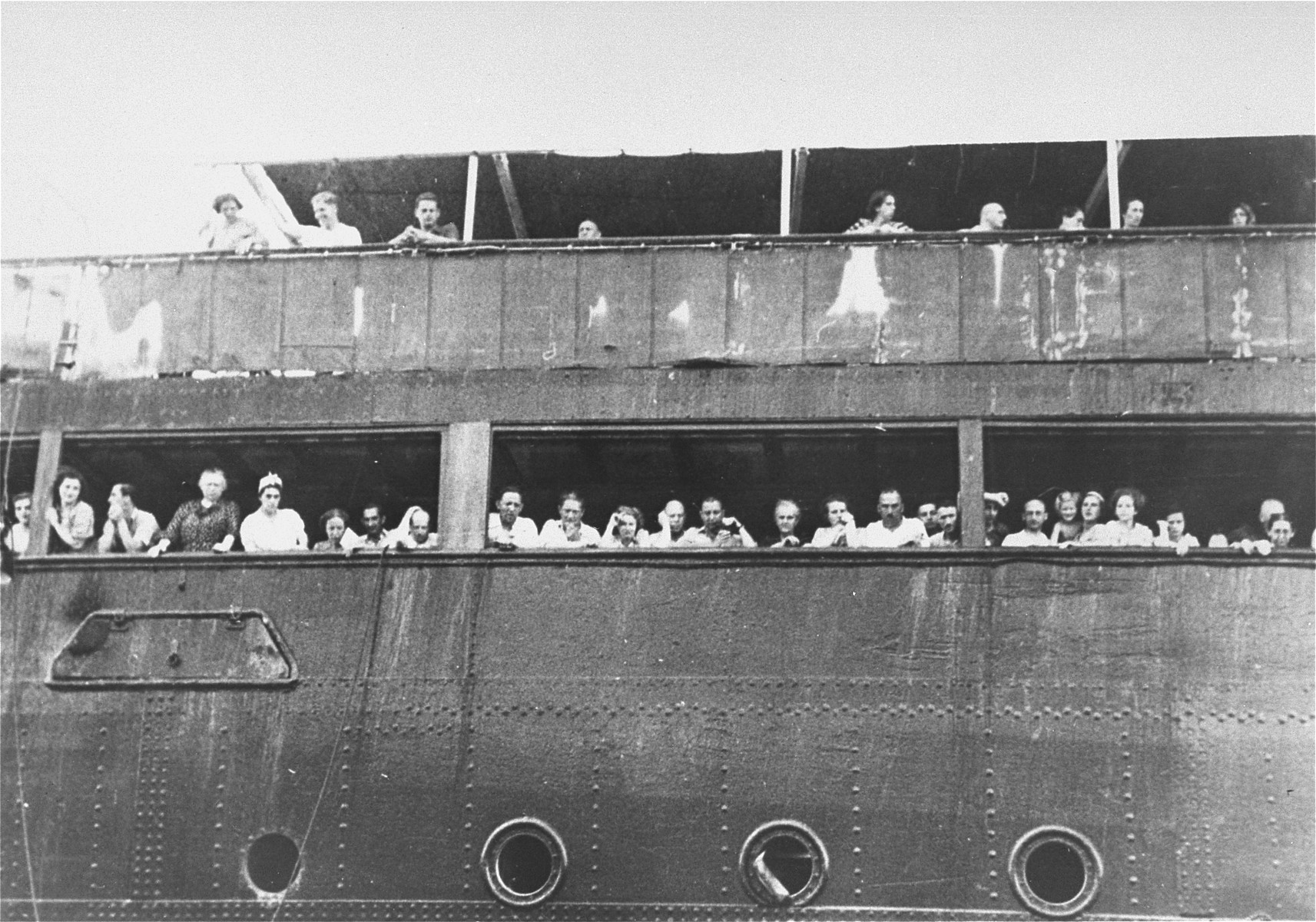 Jewish refugees aboard the MS St. Louis attempt to communicate with friends and relatives in Cuba, who were permitted to approach the docked vessel in small boats.