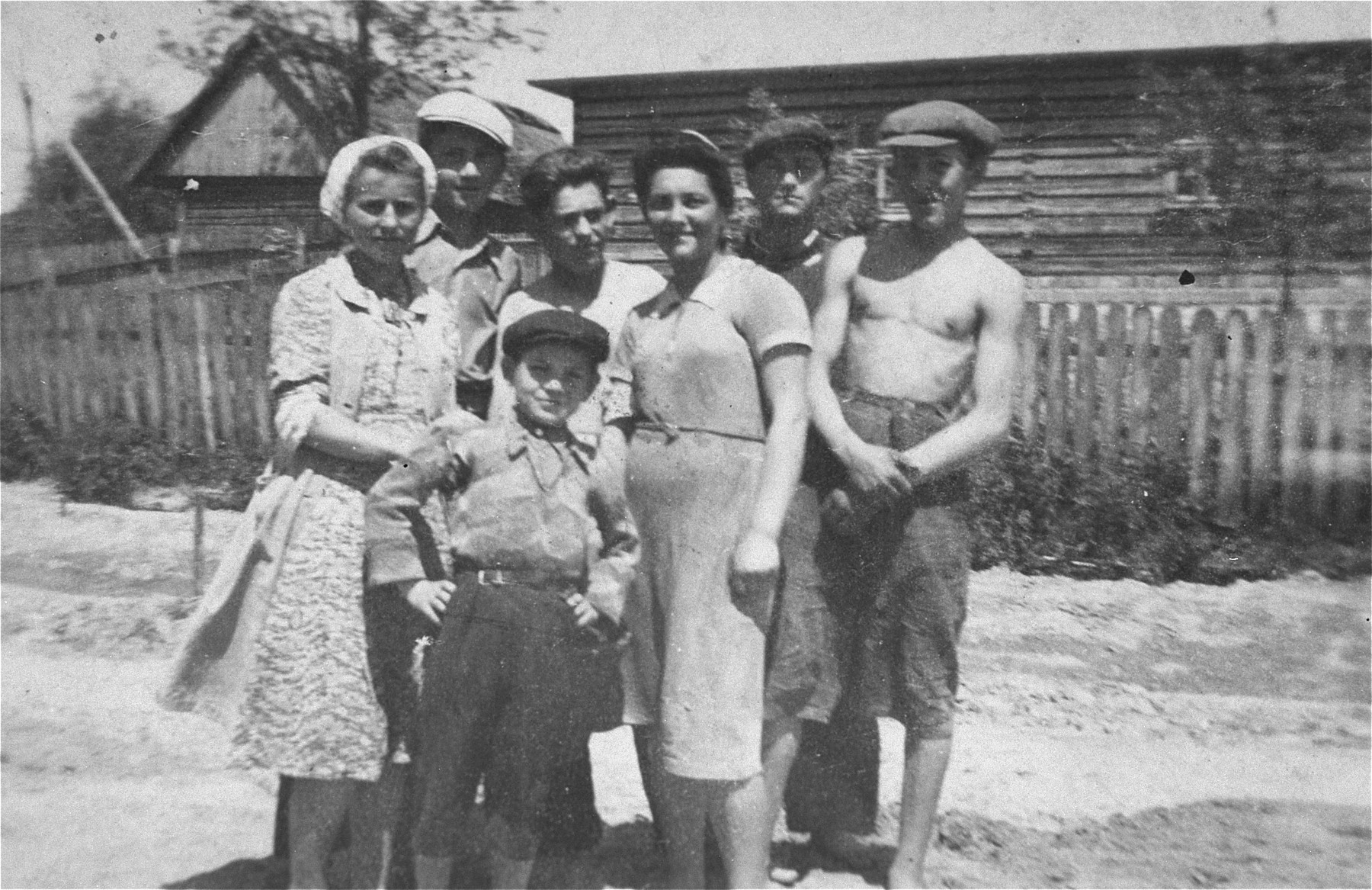 Group portrait of Jewish youth in the Kolbuszowa ghetto.    Among those pictured are Simcha Notowicz (back row, second from the left), Joel Graeber (standing behind the younger boy), Jankiel Plafkier (second from the right), and Srulek Biegeleisen (far right).