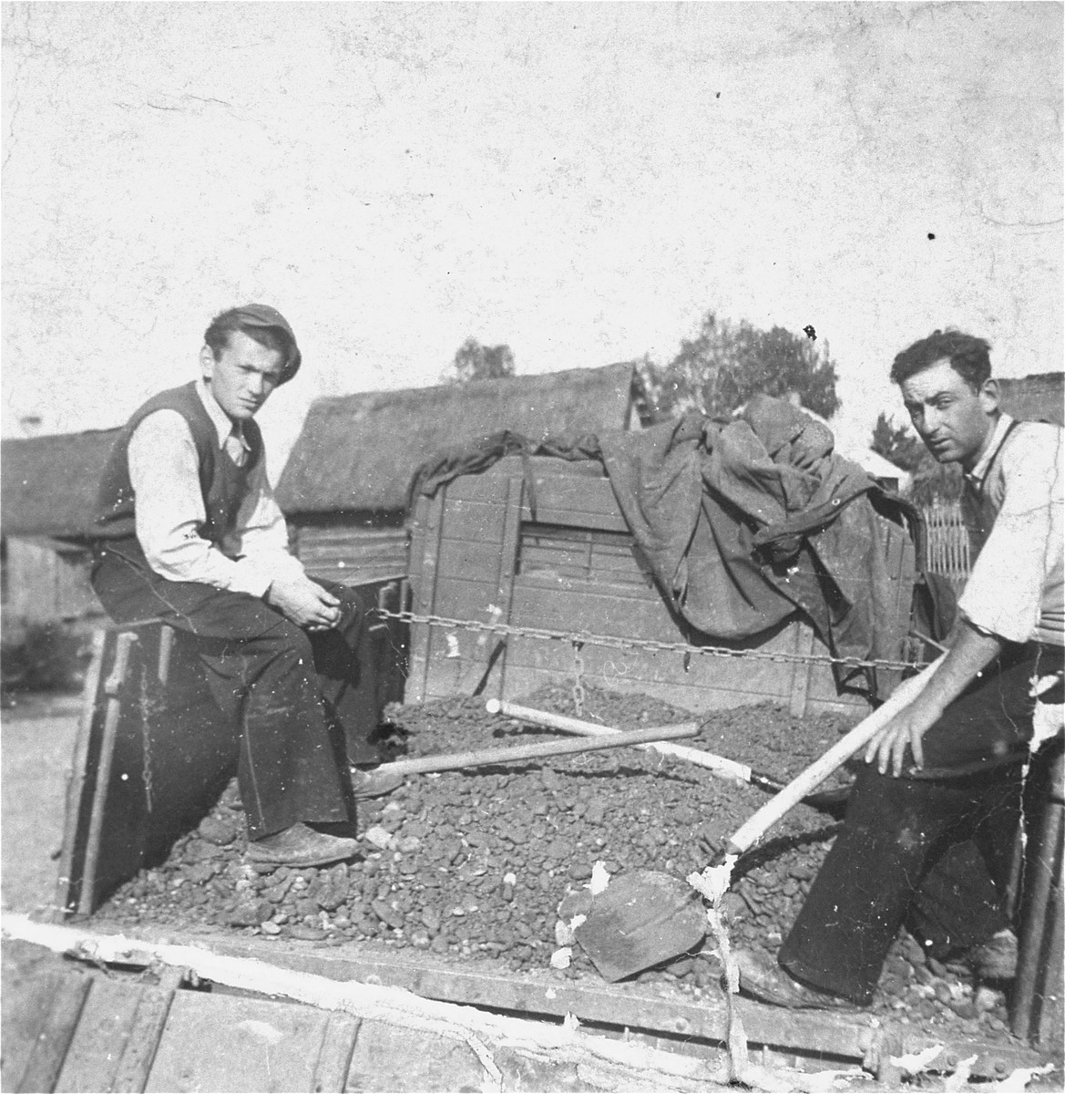 Two young Jewish men at forced labor in the Kolbuszowa ghetto.  Pictured are Maniek Orgel and Izak Stub.
