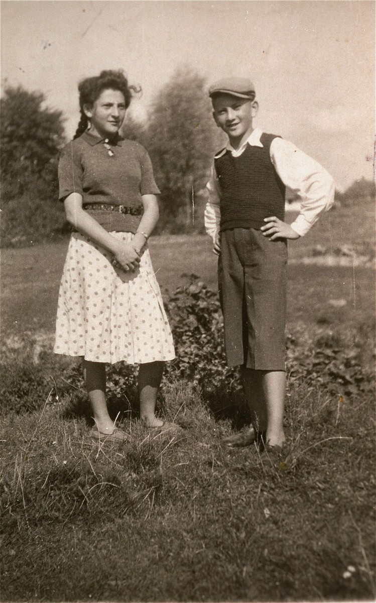 Two Jewish siblings pose outside in the Kolbuszowa ghetto.  Pictured are Manius and Niunia Notowicz.