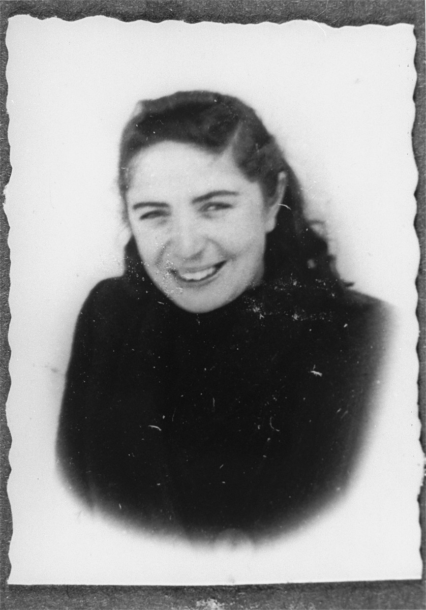 Studio portrait of a member of the administrative staff of the Kielce ghetto Judenrat (Jewish council).  This photo was one the images included in an official album prepared by the Judenrat of the Kielce ghetto in 1942.