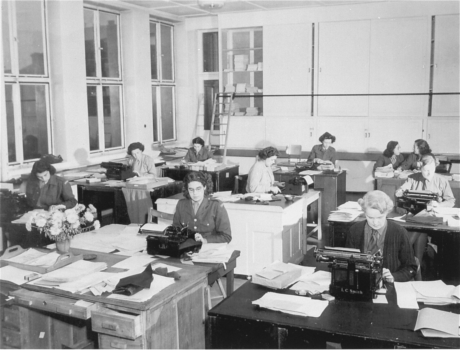 Correspondence room of the UNRRA Central Tracing Bureau, where typists write hundreds of letters daily in efforts to bring together families among the more than one million displaced persons still in western Europe.