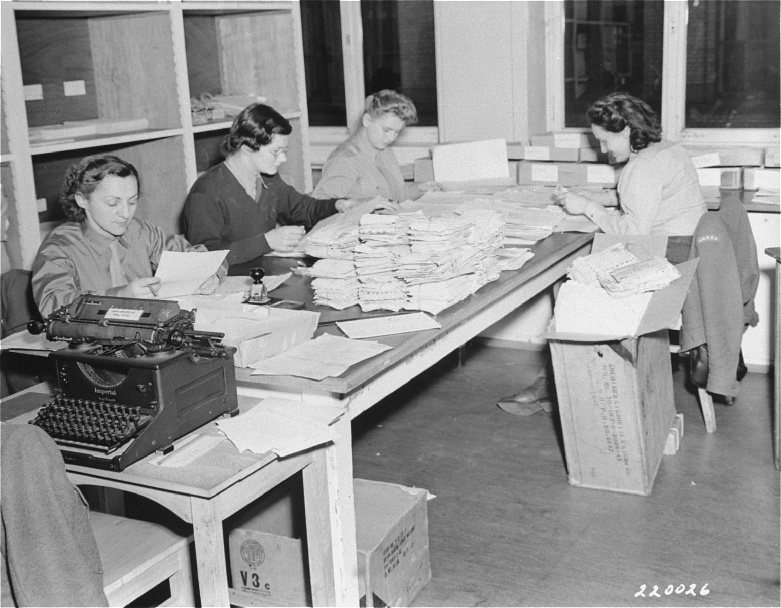 "Letters pour into ""Missing Persons"" bureau as UNRRA tries to bring together  families separated by the war.  The mail room of the UNRRA central tracing bureau receives thousands of letters daily from people trying to piece together families from the more than a milion former slave laborers and prisoners of the Nazis still remaing in Germany. The UNRRA bureau serves as a missing persons agency for DP's in Western Germany."