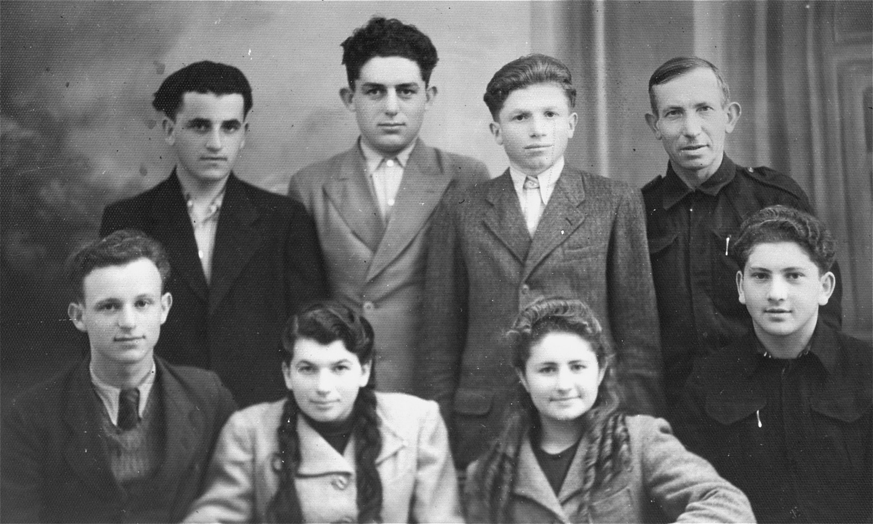 Group portrait of Jewish DP youth in Kolbuszowa.  Among those pictured is Manius Notowicz (front row, right) and Markus Rohtbart (top row, right).