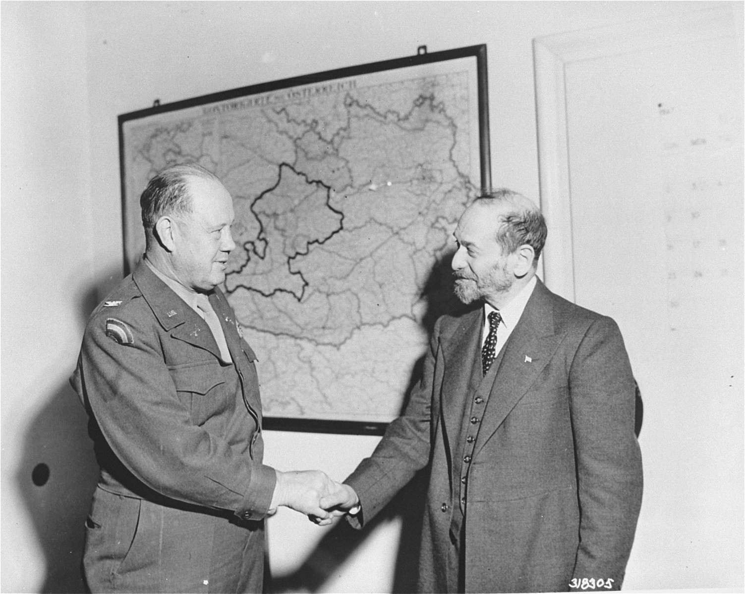 Rabbi Ephraim Epstein, one of the leading Jewish clergymen in the United States, is greeted upon his arrival by Col. Henning Linden, Chief of Staff, Zone Command, Austria.